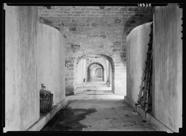 The vintage season at Richon-le-Zion, Aug. 1939. Large subterranean cold storage concrete containers. Showing arcades of extensive cellars