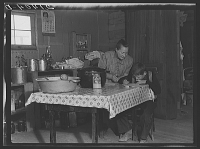 The youngest Wardlow boy copies out a recipe for his mother. Dead Ox Flat, Malheur County, Oregon