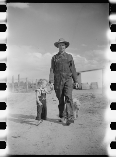 Thomas W. Beede, resettlement client, Western Slope Farms, Colorado poses with his youngest daughter