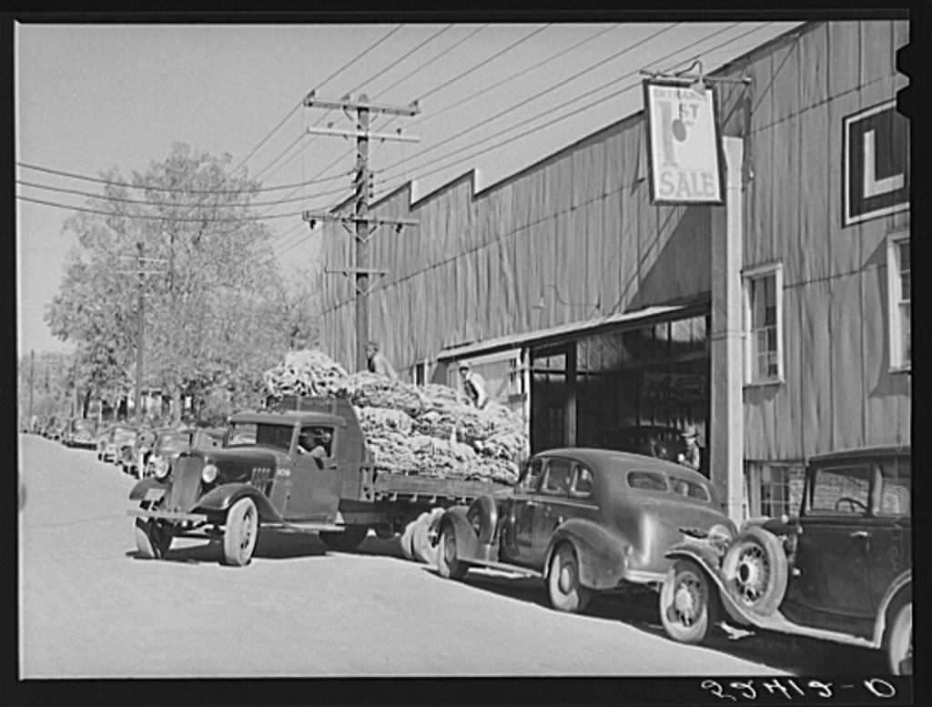 Tobacco is taken in trucks from warehouse to cigarette factories. Durham, North Carolina