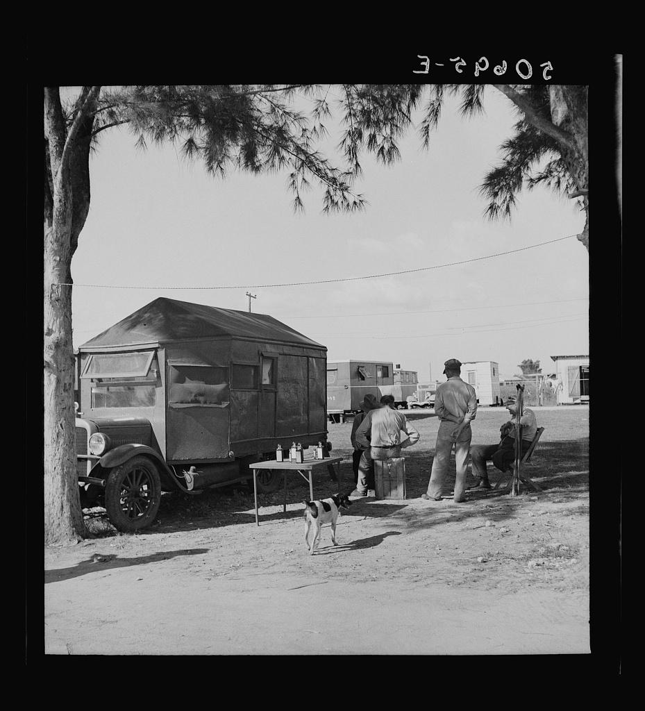 Tom Tom Herb Tonic trailertruck in transient laborer's cabin and trailer camp. Belle Glade, Florida