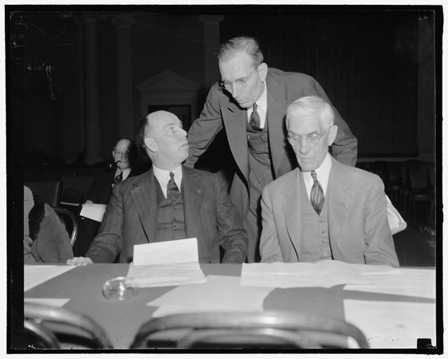 Townsendites have a day at hearings. Washington, D.C., Feb. 8. Rep. Ralph O. Brewster, Maine, L.W. Jeffery, Vice President of the Townsend National Recovery Plan, Inc. and Dr. Towsend, going over a few points on their testimony before the hearings today of the House Ways and Means Committee. Rep. Brewster told the Committee that adoption of the Townsend Bill will allow the government to do away with other forms of relief and would allow the budget to be balanced, 2-8-39