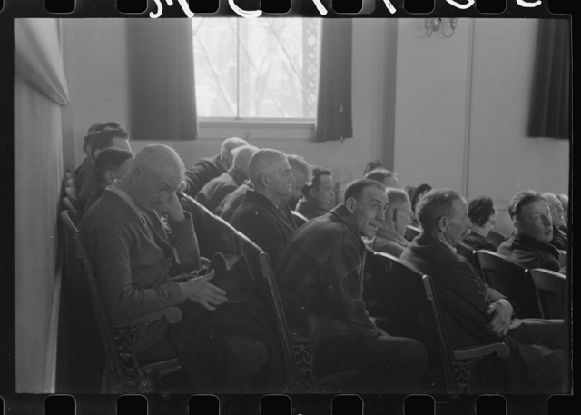 Townspeople listening to discussion during meeting, Woodstock, Vermont
