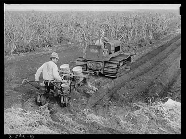 Tractor-driven combination bean planter and fertilizer used on large tracts of farmlands around Lake Okeechobee and Clewiston, Florida