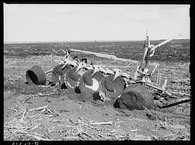 Tractor-driven disc gang plough used on large tracts of land before planting sugarcane. USSC (United States Sugar Corporation). Clewiston, Florida