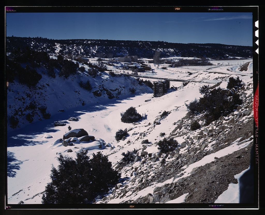 Trampas, Taos County, New Mexico, a Spanish-American village in the foothills of the Sangre de Cristo Mountains dating back to 1700 which was once a sheep raising center. Due to overgrazing and loss of range title, its inhabitants now work as migratory labor and at subsistence farming