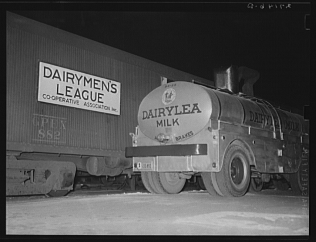 Transferring mild from tank cars to truck. Jersey City, New Jersey