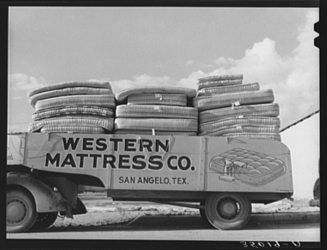 Truck filled with mattresses. This mattress company uses these trucks to distribute its products throughout Texas. San Angelo, Texas