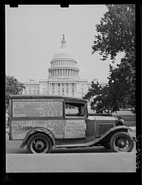 Truck of itinerant preacher parked in front of United States Capitol. Washington, D.C.