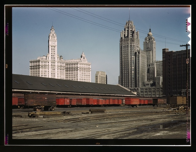 Trucks unloading at the inbound freight house of the Illinois Central Railroad, South Water Street freight terminal, Chicago, Ill.