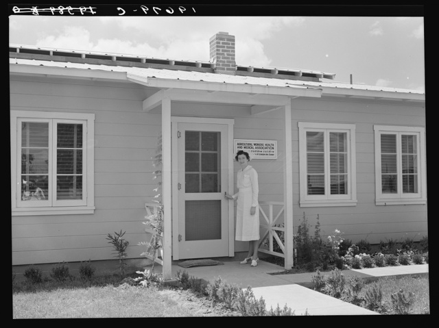 Tulare County, California. Farm Security Administration (FSA) camp for migratory agricultural workers at Farmersville. Resident nurse and clinic building of Agricultural Workers' Health and Medical Association