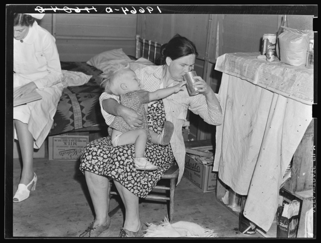 Tulare County, California. In Farm Security Administration (FSA) camp. Mother from Oklahoma tends baby with dysentery and awaits arrival of FSA camp resident nurse