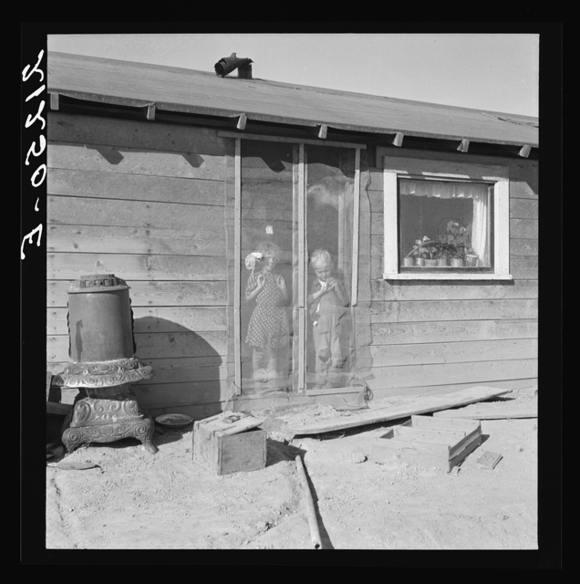 Two of the seven Browning children in doorway of their Oregon home. Dead Ox Flat. Malheur County, Oregon. General Caption number 67-111