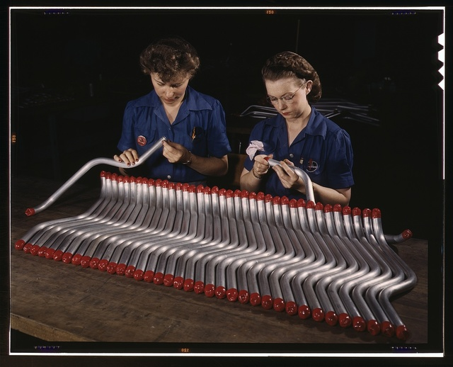 "Two women workers are shown capping and inspecting tubing which goes into the manufacture of the ""Vengeance"" (A-31) dive bomber made at Vultee's Nashville division, Tennessee. The ""Vengeance"" (A-31) was originally designed for the French. It was later adopted by the R.A.F. and still later by the U.S. Army Air Forces. It is a single-engine, low-wing plane, carrying a crew of two men and having six machine guns of varying calibers"