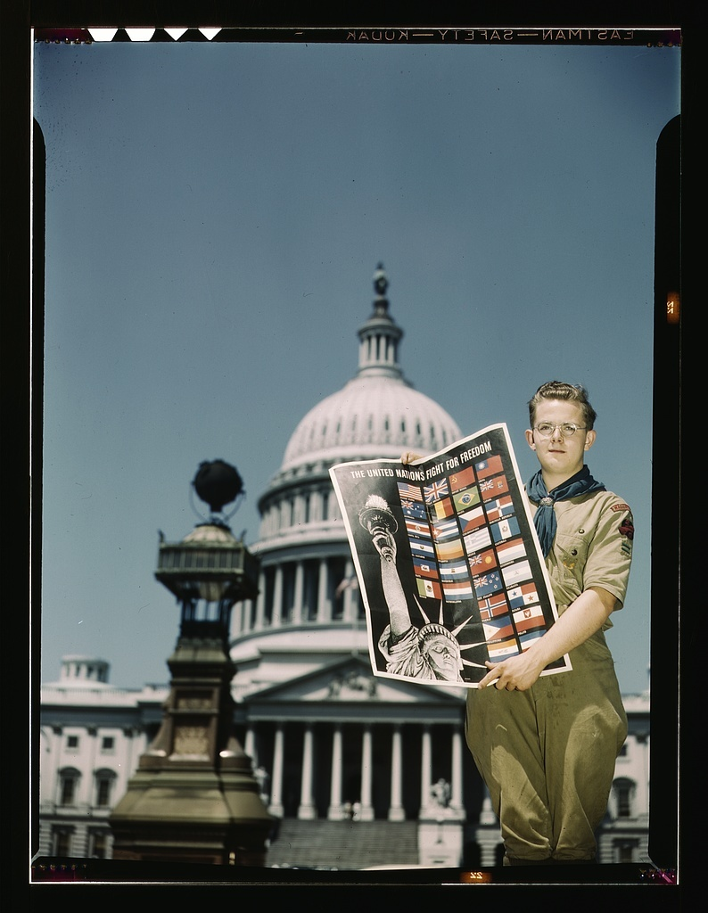 United Nations Fight for Freedom: Boy Scout in front of Capitol. They help out by delivering posters to help the war effort