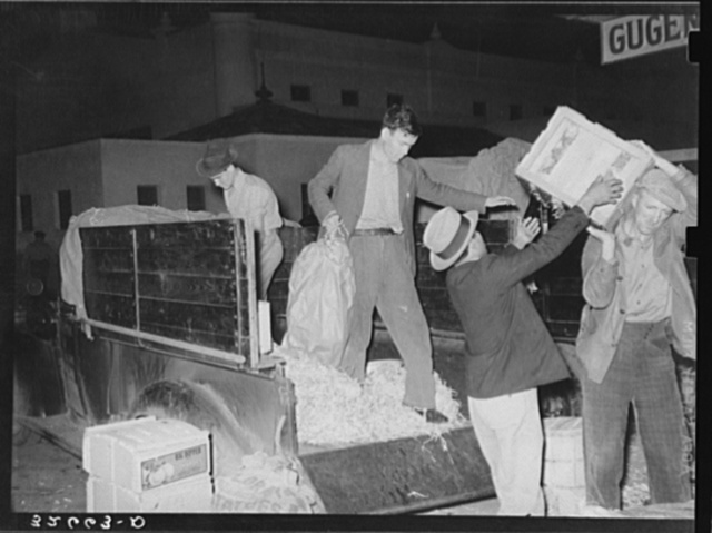 Unloading fruit and vegetables from truck at wholesale house. San Antonio, Texas