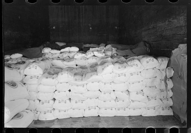 [Untitled photo, possibly related to: Flour in railroad freight car at wholesale grocers, San Angelo, Texas]