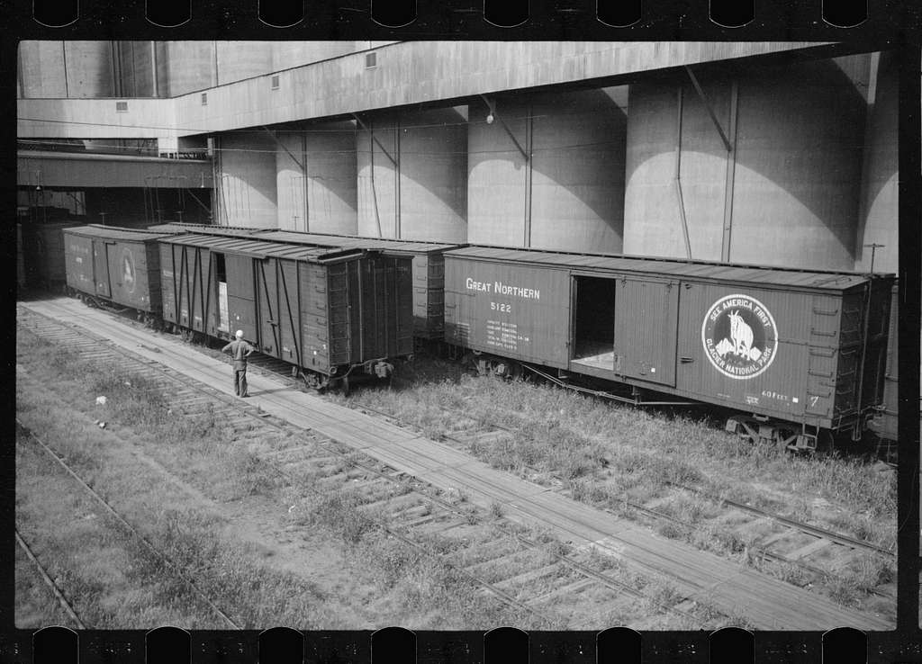 Untitled photo, possibly related to: Freight car and flour mill, Minneapolis, Minnesota