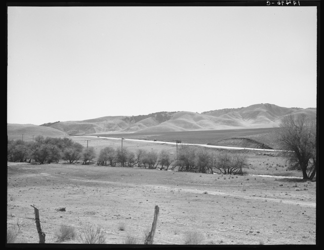 U.S. 99 on ridge over Tehachapi Mountains. Heavy truck route between Los Angeles and San Joaquin Valley, California, over which migrants travel back and forth