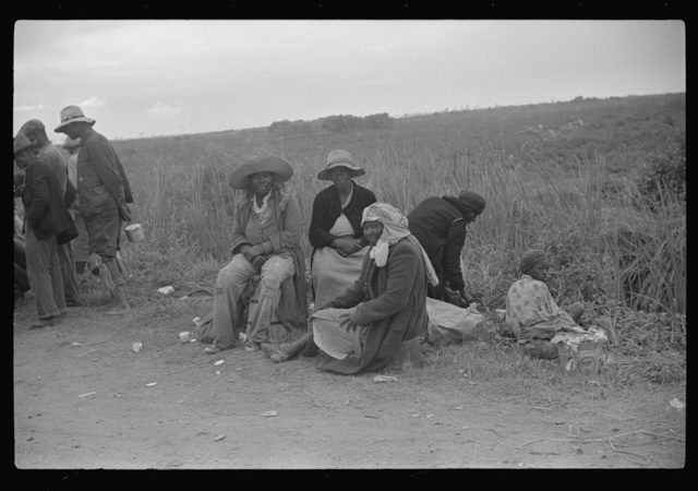 Vegetable pickers, migrants, waiting after work to be paid. Near Homestead, Florida