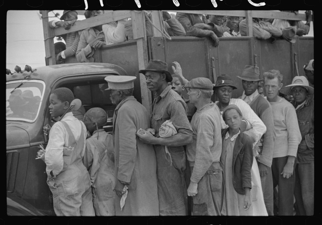 Vegetable workers, migrants, waiting after work to be paid. Near Homestead, Florida