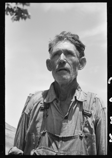 "Veteran migrant agricultural worker. He has followed the road for about thirty years. When asked where his home was he said, ""It's all over."" He was camped in Wagoner County, Oklahoma"