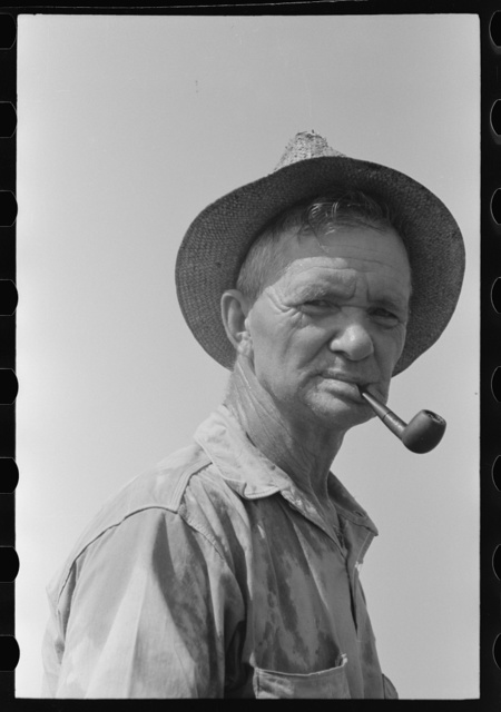 Veteran oil worker now in a ditch-digging gang. He has done everything in oil fields, from drilling to pipeline work. Seminole oil field, Oklahoma