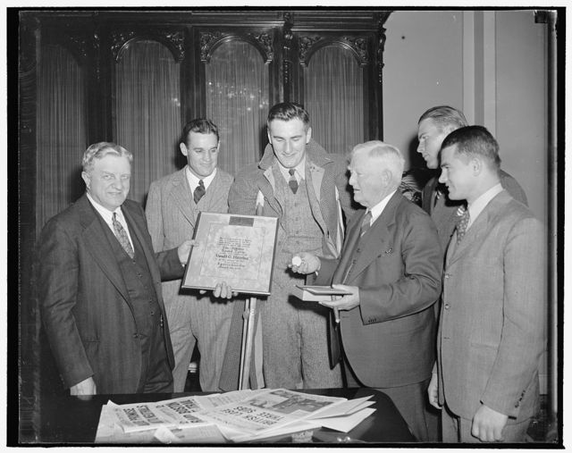 [Vice President John N. Garner and group; with award: Athletic Round table certificate to Donald G. Herring, winner of National Sportsmanship Award for 1939