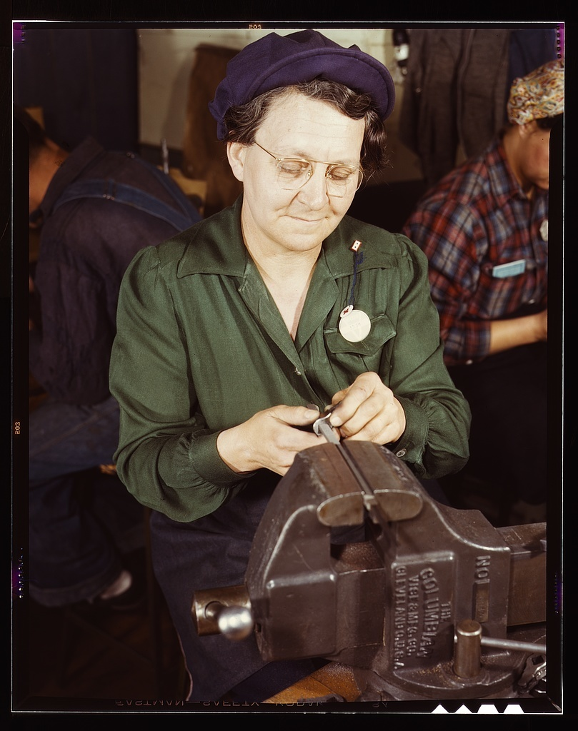 War production worker at the Vilter [Manufacturing] Company making M5 and M7 guns for the U.S. Army, Milwaukee, Wis. Ex-housewife, age 49, now doing bench work on small gun parts. Son [is] Second L[ieutenan]t, Son-in-law, Capt[ain] in Army