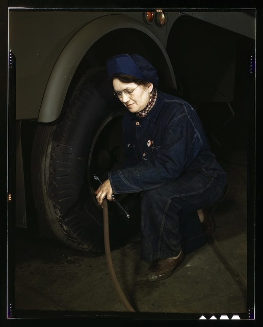 War production workers at the Heil Company making gasoline trailer tanks for the U.S. Army Air Corps, Milwaukee, Wis. Mrs. Angeline Kwint, age 45, an ex-housewife, checking the tires of trailers. Her husband and son are in the U.S. Army
