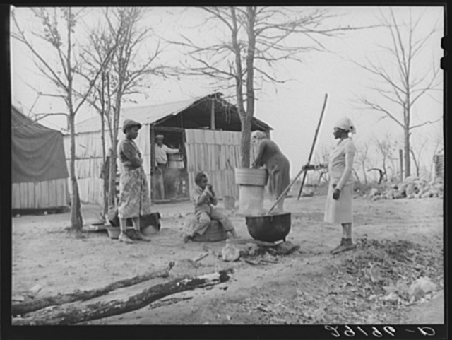 Washing clothes at camp for evicted sharecroppers. Butler County, Missouri