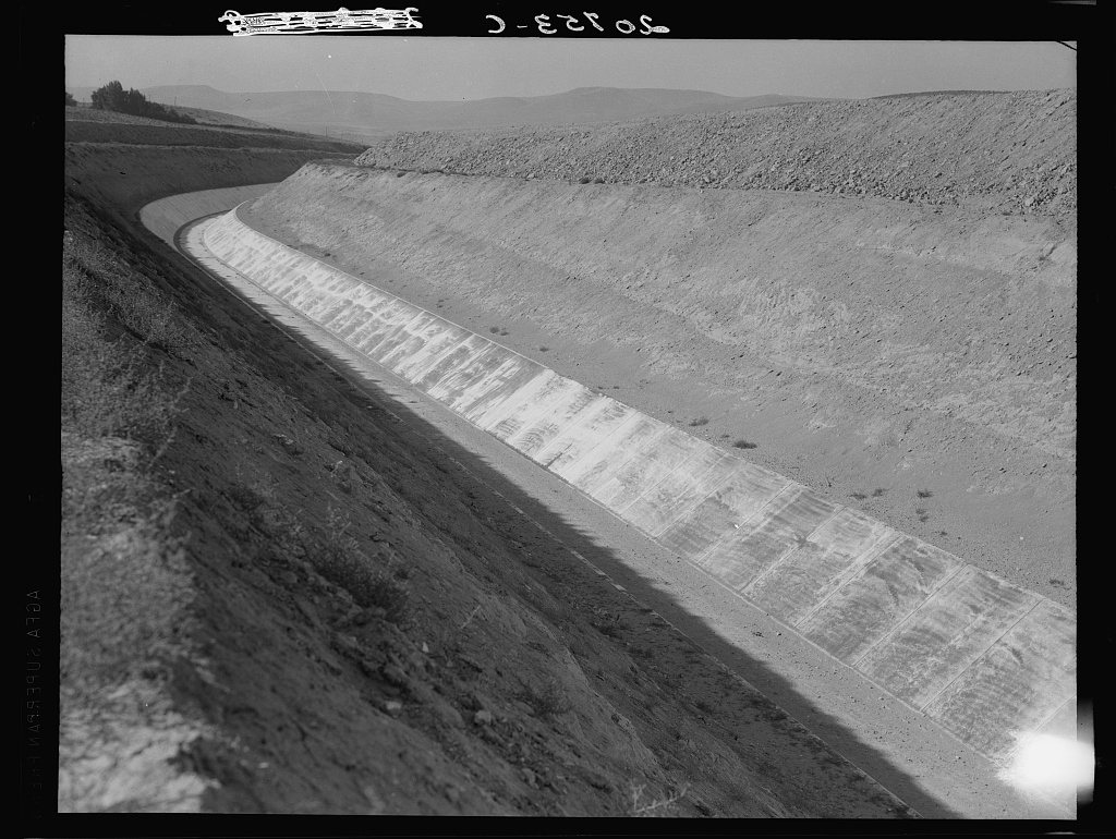 Washington, Yakima County, Roza Irrigation Canal. Sides concrete, lined by machine. The project, when complete in 1945, will open 72,000 acres to cultivation in East Yakima and West Benton Counties