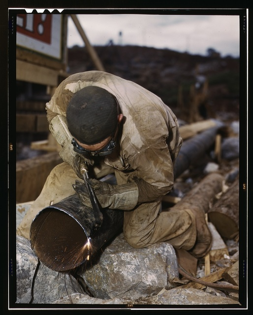Welder at work on Douglas Dam, Tenn. (TVA)