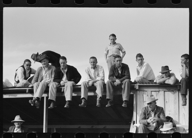 West Texans sitting on top of grandstand roof at horse auction, Eldorado, Texas