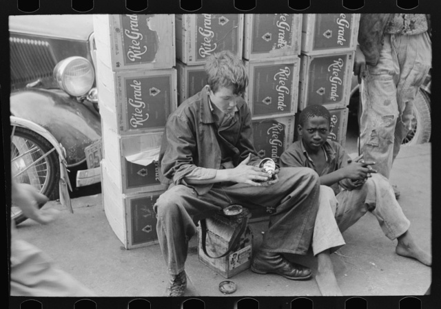 White and Negro bootblacks in Market Square, Waco, Texas