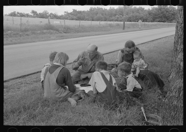 White migrant family eating lunch of blackberry pie on the highway east of Fort Gibson, Oklahoma