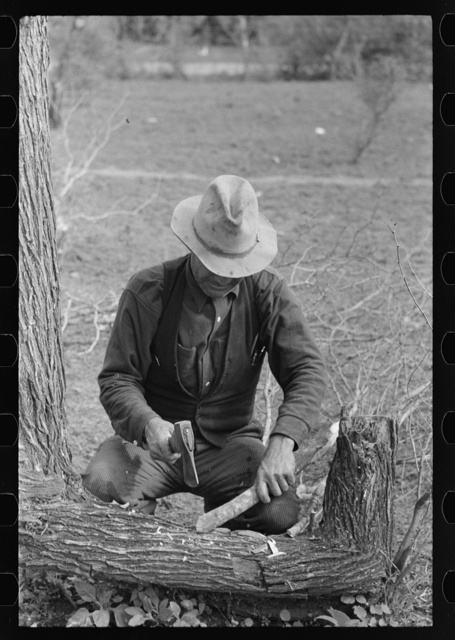 White migrant making stakes for setting up his tent near Harlingen, Texas