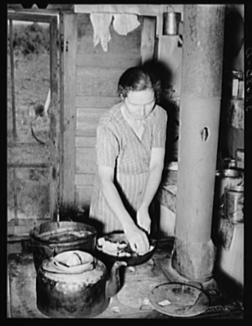 Wife of farmer now on WPA (Works Progress Administration/Work Projects Administration) roadwork making blackberry pie. Near Sallisaw, Oklahoma