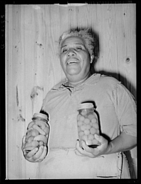 Wife of FSA (Farm Security Administration) client with home-canned vegetables. Sabine Farms, Marshall, Texas