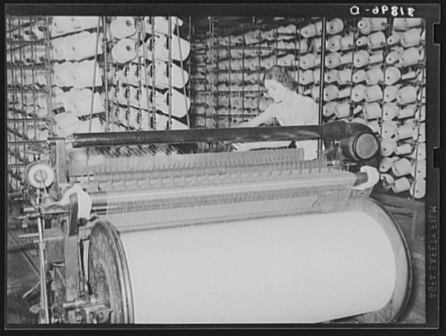 Winding machine, where large cylinders of warp are prepared for later use in weaving cloth. Laurel mills, Mississippi