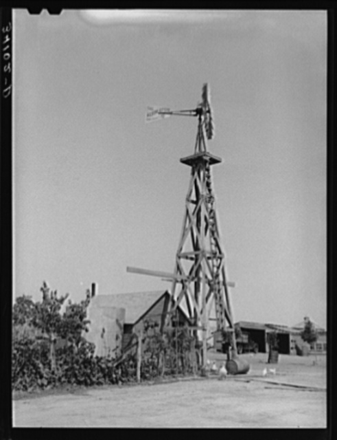 Windmill on farm of William Rall, FSA (Farm Security Administration) client in Sheridan County, Kansas