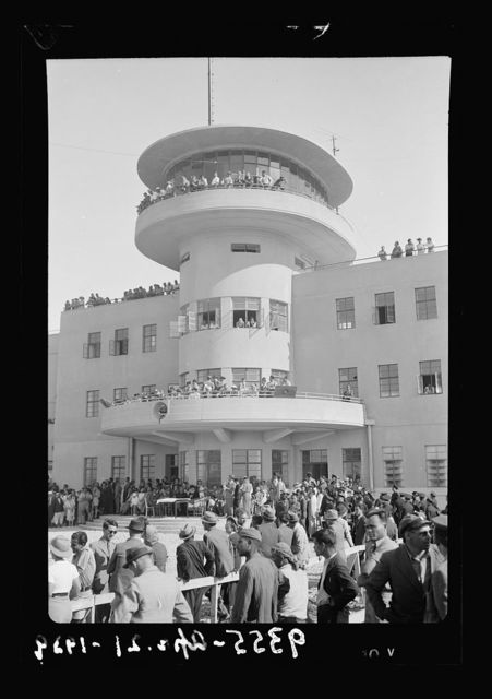 Wings over Palestine-Certificates of Flying School, April 21, 1939. Central part of Air Terminal bld'g.[i.e., building] High Commisioner on balcony [Lydda Air Port]