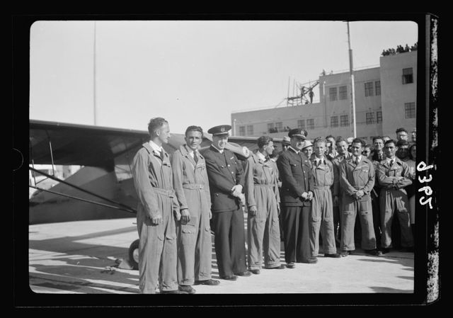 Wings over Palestine-Certificates of Flying School, April 21, 1939. Young pilots who received their flying licenses with instructors [Lydda Air Port]