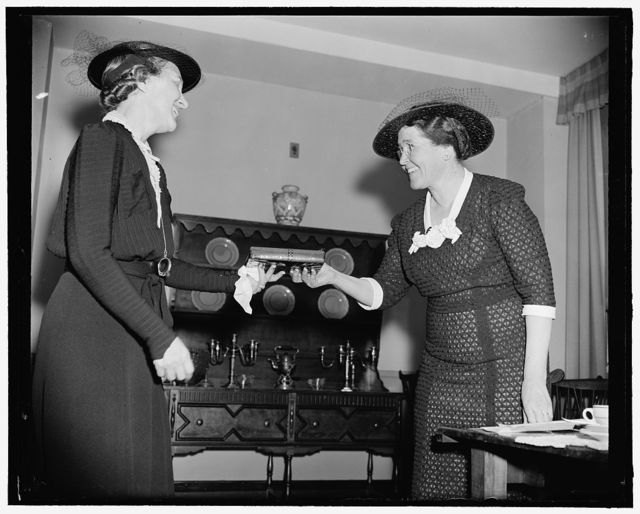 [Wives] of Congressmen in speaking class have commencement and awarding of prizes. Washington, D.C., March 17. Mrs. Hugh Butler's little publicized speaking class for wives of Congressmen today completed its schedule of classes and the group gathered at a luncheon to award prizes. Mrs. Will M. Whittington, wife of the congressman from Mississippi won the award as best speaker and was presented with a book of fine speeches by Mrs. Hugh Butler. Left to right: Mrs. Whittington and Mrs. Butler, 3-17- 39