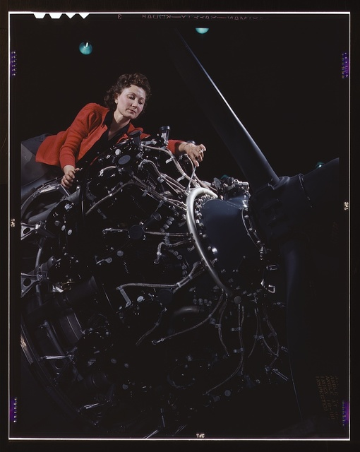 Woman at work on motor, Douglas Aircraft Company, Long Beach, Calif.