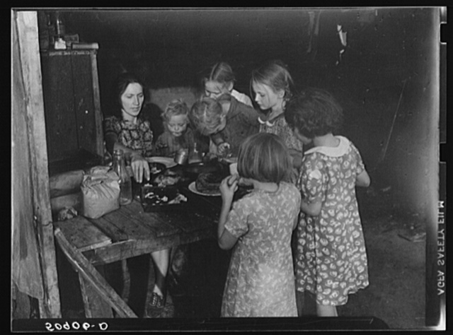 Woman migrant packinghouse worker from Tennessee with four children and two relatives eating supper. Belle Glade, Florida