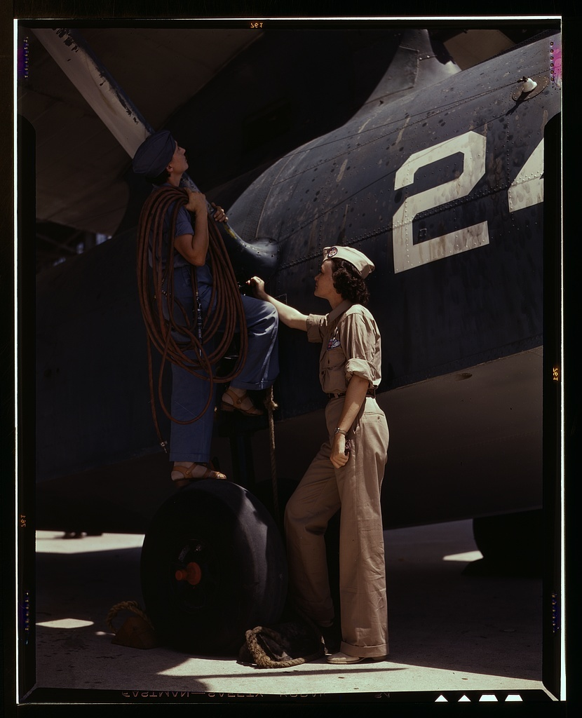 Women are contributing their skills to the nation's needs by keeping our country's planes in top-notch fighting condition, Corpus Christi, Texas. Wife of a disabled World War I veteran, Mrs. Cora Ann Bowen (left) works as a cowler at the Naval Air Base. Mrs. Eloise J. Ellis is a senior supervisor in the Assembly and Repairs department