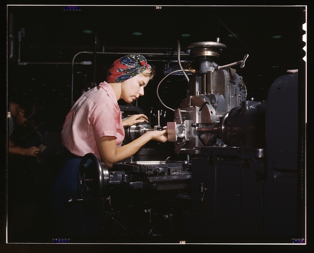 """Women become skilled shop technicians after careful training in the school at the Douglas Aircraft Company plant, Long Beach, Calif. Most important of the many types of aircraft made at this plant are the B-17F (""""Flying Fortress"""") heavy bomber, the A-20 (""""Havoc"""") assault bomber and the C-47 heavy transport plane for the carrying of troops and cargo"""