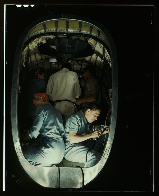 Working inside fuselage of a Liberator Bomber, Consolidated Aircraft Corp., Fort Worth, Texas