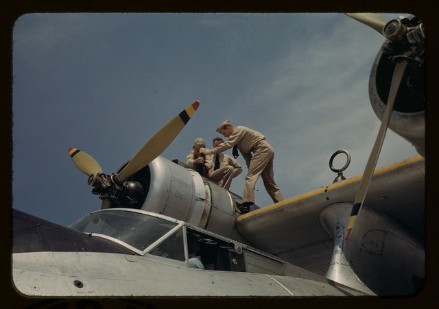 Working on a plane at the Naval Air Base, Corpus Christi, Texas